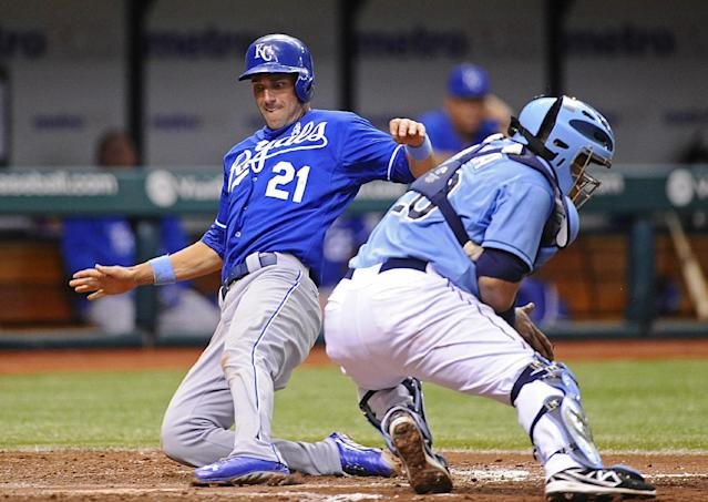 Kansas City Royals' Jeff Francoeur, left, scores in front of Tampa Bay Rays catcher Jose Molina off of Alex Gordon's one-run single during the sixth inning of a baseball game Sunday, June 16, 2013, in St. Petersburg, Fla. (AP Photo/Brian Blanco)