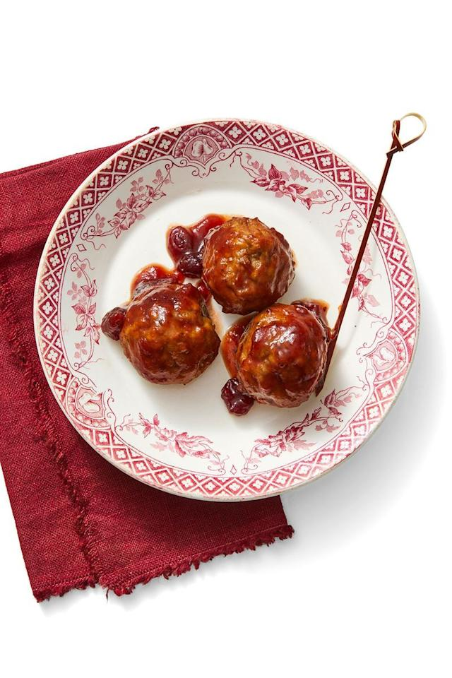 """<p>Turn store-bought meatballs into a delicious Thanksgiving appetizer by simply adding cranberry sauce. <br></p><p><em><a href=""""https://www.womansday.com/food-recipes/food-drinks/a29463992/tangy-cranberry-meatballs-recipe/"""" target=""""_blank"""">Get the recipe for Tangy Cranberry Meatballs.</a></em></p>"""