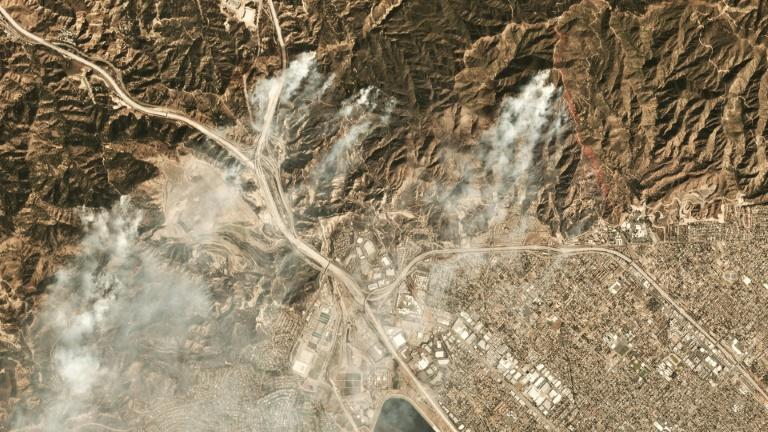 Smoke from the Saddleridge fire about 20 miles north of downtown Los Angeles is seen in this image from Planet Labs Inc