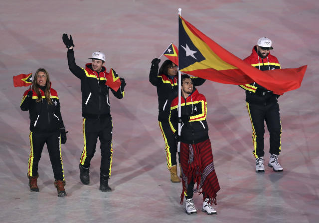 <p>Yohan Goncalves Goutt carries the flag of Timor-Leste during the opening ceremony of the 2018 Winter Olympics in Pyeongchang, South Korea, Friday, Feb. 9, 2018. (AP Photo/Michael Sohn) </p>