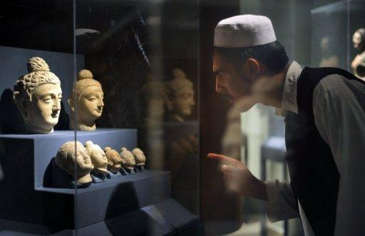 A student looks at Buddha statue heads at the National Museum of Afghanistan in Kabul. Afghanistan, which achieved notoriety for cultural barbarism when Taliban Islamists blew up the ancient Bamiyan Buddhas, this week opened an exhibition highlighting the country's Buddhist heritage