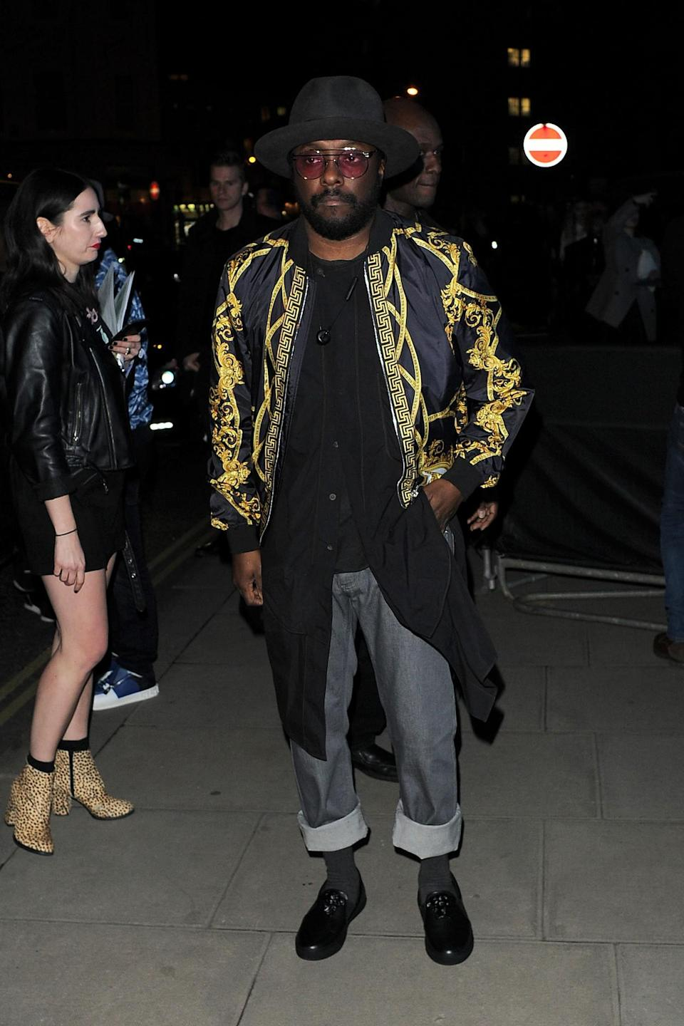 <p>will.i.am wore a gold-and-black printed coat. <i>[Photo: Getty]</i> </p>