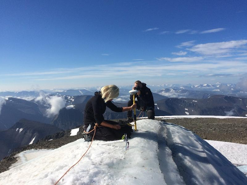 A handout picture released by Stockholm University taken on July 31, shows Gunhild Ninis Rosqvist, a Stockholm University geography professor making measurements of the glacier atop Sweden's highest point on the southern peak of the Kebnekaise mountain in Sweden's far north