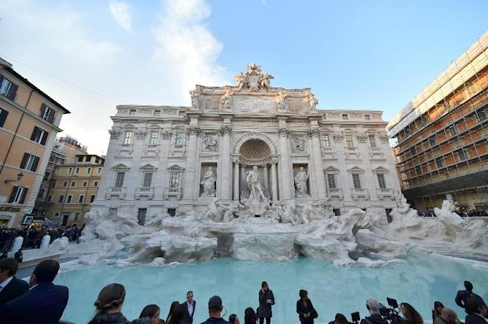 """Now the fountain, made famous by a scene in Federico Fellini's """"La Dolce Vita"""" in which Anita Ekberg wades through its pristine waters, makes the surrounding buildings in Rome's historic centre look decidedly shabby (AFP Photo/Alberto Pizzoli)"""