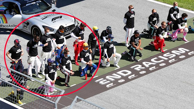Six drivers, pictured here refusing to take a knee before the Austrian Grand Prix.