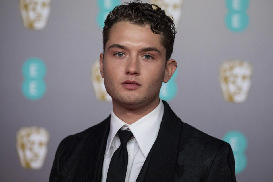 Rafferty Law poses for photographers upon arrival at the Bafta Film Awards, in central London, Sunday, Feb. 2 2020. (Photo by Vianney Le Caer/Invision/AP)