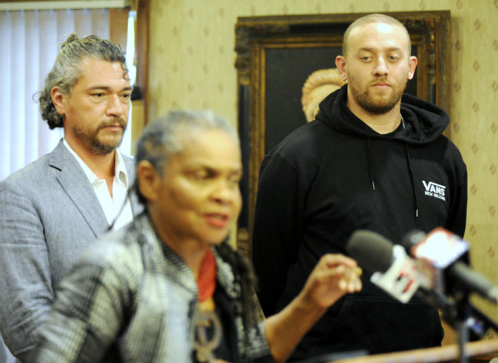 Defense lawyer Michael Kennedy, left, and defendant Jason Warnick listen to lawyer Faya Toure speak during a news conference in Selma, Ala., on Wednesday, May 2, 2021. Warnick, charged in the mysterious disappearance of a more than century-old Confederate memorial, surrendered to authorities Wednesday in what his lawyer called his first trip to the city where the alleged theft occurred. (AP Photo/Jay Reeves)