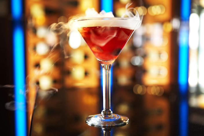 """<p><strong>Ingredients</strong></p><p>1.5 oz Belvedere Citrus vodka<br>.5 oz Crème de Cassis<br>1.5 oz sour mix<br>1 oz Domaine Chandon Brut sparkling wine</p><p><strong>Instructions</strong></p><p>Combine Belvedere Citrus vodka, Crème de Cassis, and sour mix in mixing glass. Add pellet ice to mixing tin. Shake vigorously. Add dry ice and marinated berries to chilled cocktail glass. Strain mixture into cocktail glass. Finish with Domaine Chandon Brut float.</p><p><em>From <a href=""""http://www.ocean-prime.com/"""" rel=""""nofollow noopener"""" target=""""_blank"""" data-ylk=""""slk:Ocean Prime"""" class=""""link rapid-noclick-resp"""">Ocean Prime</a> (multiple locations)</em></p><p><a class=""""link rapid-noclick-resp"""" href=""""https://go.redirectingat.com?id=74968X1596630&url=https%3A%2F%2Fdrizly.com%2Fbelvedere-vodka-citrus%2Fp14318%3Fis_autocomplete%3Dtrue&sref=https%3A%2F%2Fwww.townandcountrymag.com%2Fleisure%2Fdrinks%2Fg2839%2Fhalloween-drinks%2F"""" rel=""""nofollow noopener"""" target=""""_blank"""" data-ylk=""""slk:Buy Now"""">Buy Now</a> Belvedere Citrus, from $21.99<br><a class=""""link rapid-noclick-resp"""" href=""""https://go.redirectingat.com?id=74968X1596630&url=https%3A%2F%2Fdrizly.com%2Flejay-creme-de-cassis%2Fp16125&sref=https%3A%2F%2Fwww.townandcountrymag.com%2Fleisure%2Fdrinks%2Fg2839%2Fhalloween-drinks%2F"""" rel=""""nofollow noopener"""" target=""""_blank"""" data-ylk=""""slk:Buy Now"""">Buy Now</a> Lejay Crème de Cassis, from $24.99</p>"""