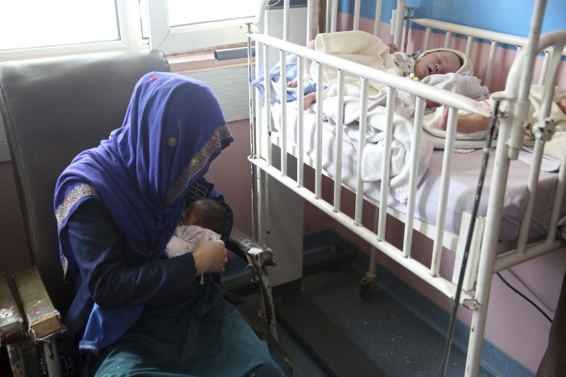 A mother breastfeeds her two-day-old baby at the Ataturk Children's Hospital a day after being rescued from another maternity hospital following a deadly attack, in Kabul, Afghanistan, Wednesday, May 13, 2020. Militants stormed the Barchi National Maternity Hospital in the western part of Kabul on Tuesday, setting off an hours-long shootout with the police and killing tens of people, including two newborn babies, their mothers and an unspecified number of nurses, Afghan officials said. (AP Photo/Rahmat Gul)