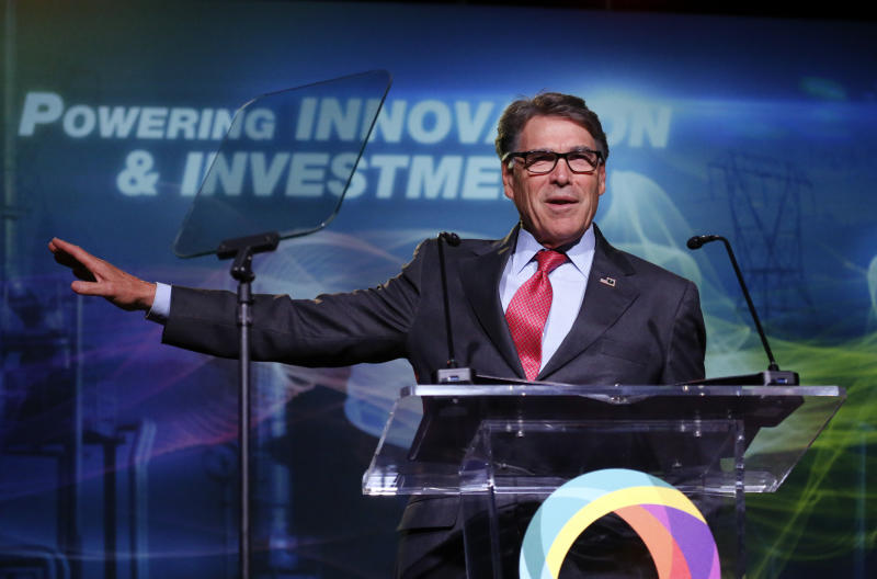 FILE - In this May 30, 2019, file photo,  Energy Secretary Rick Perry speaks at an energy summit in Salt Lake City. A business executive Perry recommended as an adviser to Ukraine's government exaggerated his military credentials, according to veterans who examined his record. Robert Joseph Bensh claimed to have been a member of the U.S. military's most elite units: Army Rangers, Special Forces and Delta Force. But a summary of his military career shows he spent less than five years in uniform, almost all of it with the Army National Guard. (AP Photo/Rick Bowmer, File)