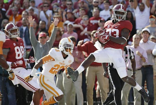 Alabama wide receiver Kevin Norwood (83) hauls in a 22-yard touchdown pass as Tennessee defensive back Cameron Sutton (23) defends during the first half of an NCAA college football game in Tuscaloosa, Ala., Saturday, Oct. 26, 2013. (AP Photo/Dave Martin)