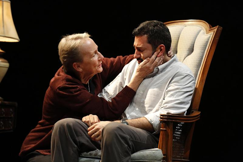 """This theater image released by Richard Kornberg & Associates shows Kathleen Chalfant, left, and Alfredo Narciso in a scene from """"Red Dog Howls,"""" performing off-Broadway at New York Theatre Workshop in New York.  (AP Photo/Kornberg & Associates, Joan Marcus)"""
