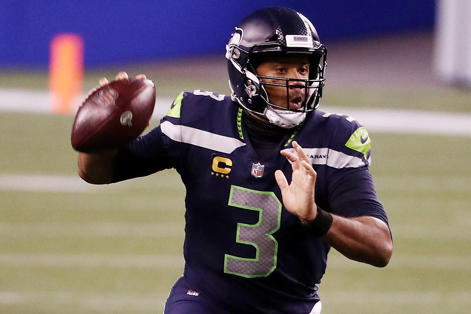 Russell Wilson #3 of the Seattle Seahawks looks to pass during the second half against the New England Patriots at CenturyLink Field on September 20, 2020 in Seattle, Washington. (Photo by Abbie Parr/Getty Images)