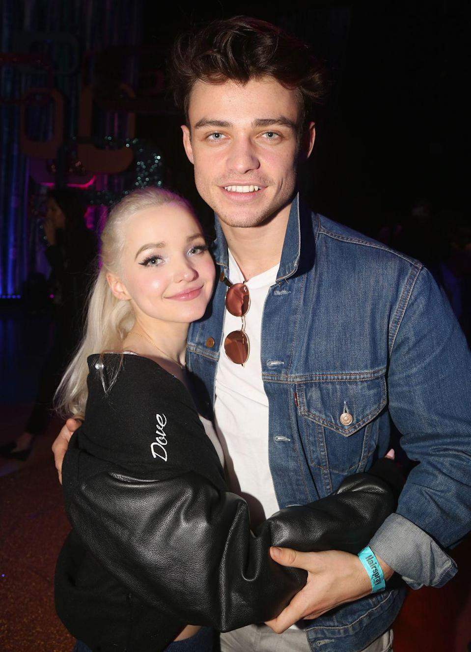 """<p>Fans did not foresee Dove and Thomas breaking up ever, but 2020 was a beast with no boundaries. After fans began speculating that <a href=""""https://www.cosmopolitan.com/entertainment/celebs/a34950384/dove-cameron-thomas-doherty-split-almost-four-years-together/#:~:text=Dove%20Cameron%20and%20Thomas%20Doherty%20have%20called%20it,almost%20four%20years%20of%20dating.&text=We%20know%20there%20have%20been,I%20decided%20to%20part%20ways."""" rel=""""nofollow noopener"""" target=""""_blank"""" data-ylk=""""slk:they ended their nearly four-year relationship"""" class=""""link rapid-noclick-resp"""">they ended their nearly four-year relationship</a>, Dove posted a statement on her and Thomas' behalf to her Instagram Stories and said, """"In October, Thomas and I decided to part ways. The decision was incredibly difficult, but we still have love for each other, and will remain friends. Thank you for allowing us our privacy in this time."""" 😭</p>"""