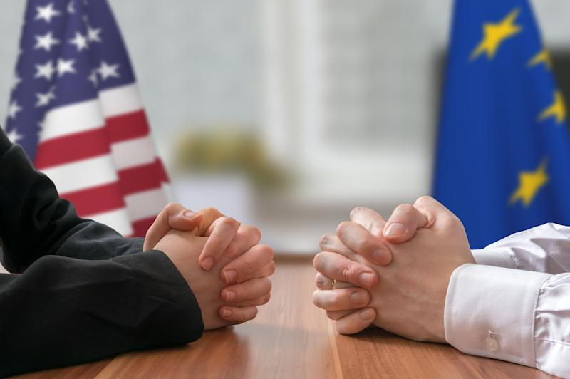 Negotiation of USA and European Union. Statesman or politicians with clasped hands.