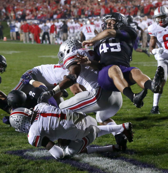 Ohio State cornerback Bradley Roby (1) and Ryan Shazier block the punt of Northwestern's Brandon Williams (49) during the first half of an NCAA football game Saturday, Oct. 5, 2013, in Evanston, Ill. (AP Photo/Charles Rex Arbogast)