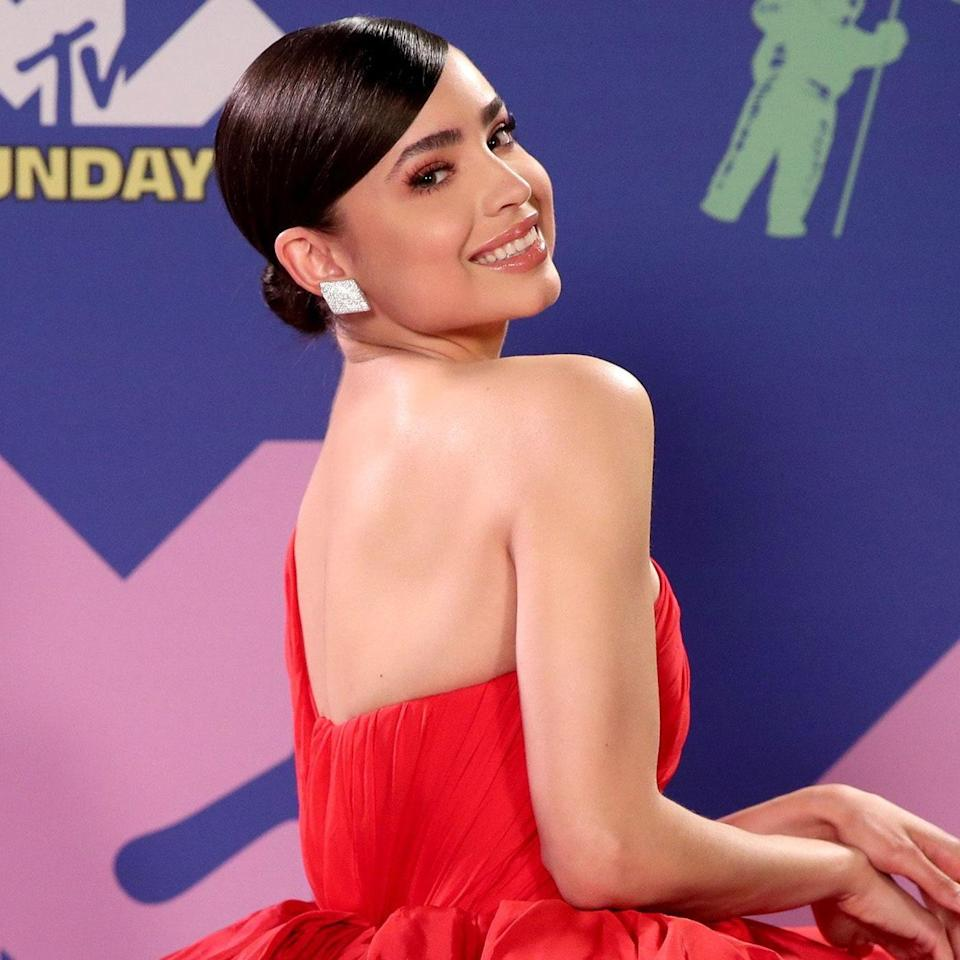 The <em>Descendants</em> actor went for a classic monochromatic makeup look with coral eyes and lips that perfectly pair with her bright scarlet gown. As for her hair, she kept it sleek and simple in a low-hung chignon to keep the focus on the makeup.