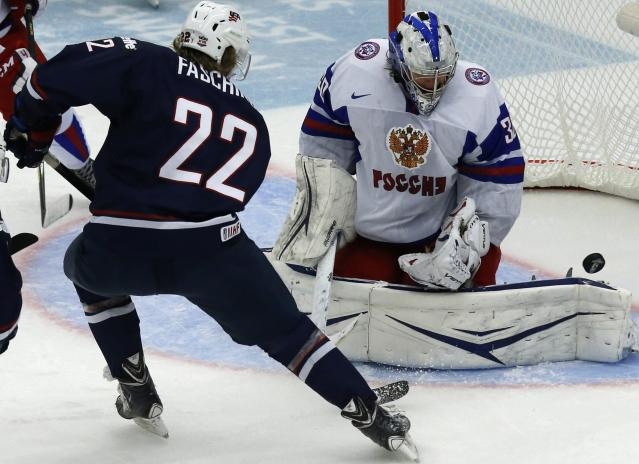 Hudson Fasching (L) of the U.S. tries to score past Russia's goalie Andrei Vasilevski during the first period of their quarter-final game at the IIHF World Junior Championship ice hockey game in Malmo, Sweden, January 2, 2014. REUTERS/Alexander Demianchuk (SWEDEN - Tags: SPORT ICE HOCKEY)