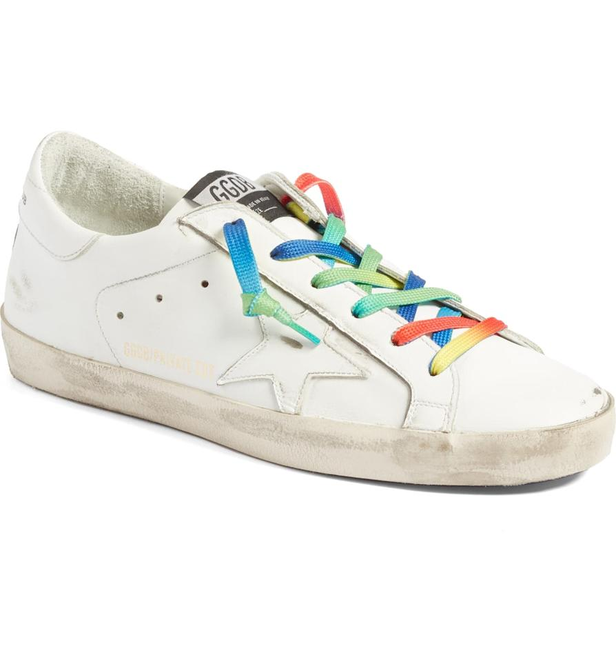 "<p>Add a little fun to your wardrobe with this <a href=""https://www.popsugar.com/buy/Golden-Goose-Superstar-Rainbow-Low-Top-Sneaker-487201?p_name=Golden%20Goose%20Superstar%20Rainbow%20Low-Top%20Sneaker&retailer=shop.nordstrom.com&pid=487201&price=565&evar1=fab%3Auk&evar9=46575746&evar98=https%3A%2F%2Fwww.popsugar.com%2Ffashion%2Fphoto-gallery%2F46575746%2Fimage%2F46575760%2FGolden-Goose-Superstar-Rainbow-Low-Top-Sneaker&list1=shopping%2Cshoes%2Csneakers%2Cdesigner&prop13=api&pdata=1"" rel=""nofollow"" data-shoppable-link=""1"" target=""_blank"" class=""ga-track"" data-ga-category=""Related"" data-ga-label=""https://shop.nordstrom.com/s/golden-goose-superstar-rainbow-low-top-sneaker-women-nordstrom-exclusive/5268367?origin=category-personalizedsort&amp;breadcrumb=Home%2FDesigner%2FWomen%2FDesigner%20Shoes%2FSneakers&amp;color=white%2F%20rainbow"" data-ga-action=""In-Line Links"">Golden Goose Superstar Rainbow Low-Top Sneaker</a> ($565).</p>"