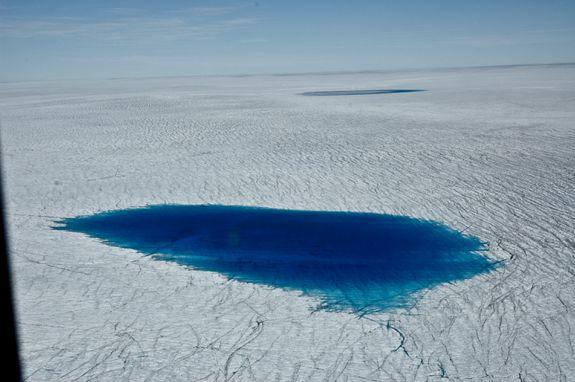 Dark meltwater on Greenland's surface.