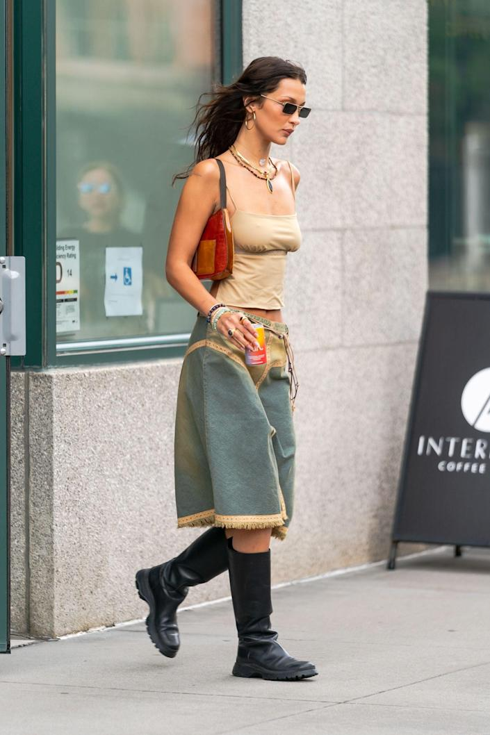 <p>Bella Hadid made a case for the denim skirt in a nostalgia-inducing version, which she paired with knee-high boots. Dare we say this is ideal transitional style?</p>