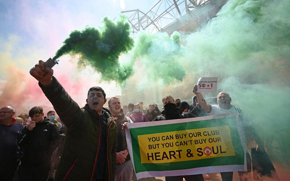 Supporters protest against Manchester United's owners, outside English Premier League club Manchester United's Old Trafford stadium in Manchester, north west England on May 2, 2021,