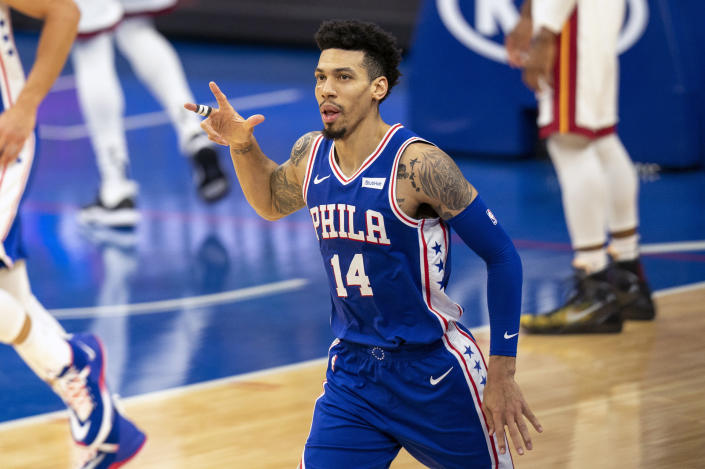 Philadelphia 76ers' Danny Green reacts to his 3-point shot during the second half of an NBA basketball game against the Miami Heat, Tuesday, Jan. 12, 2021, in Philadelphia. (AP Photo/Chris Szagola)