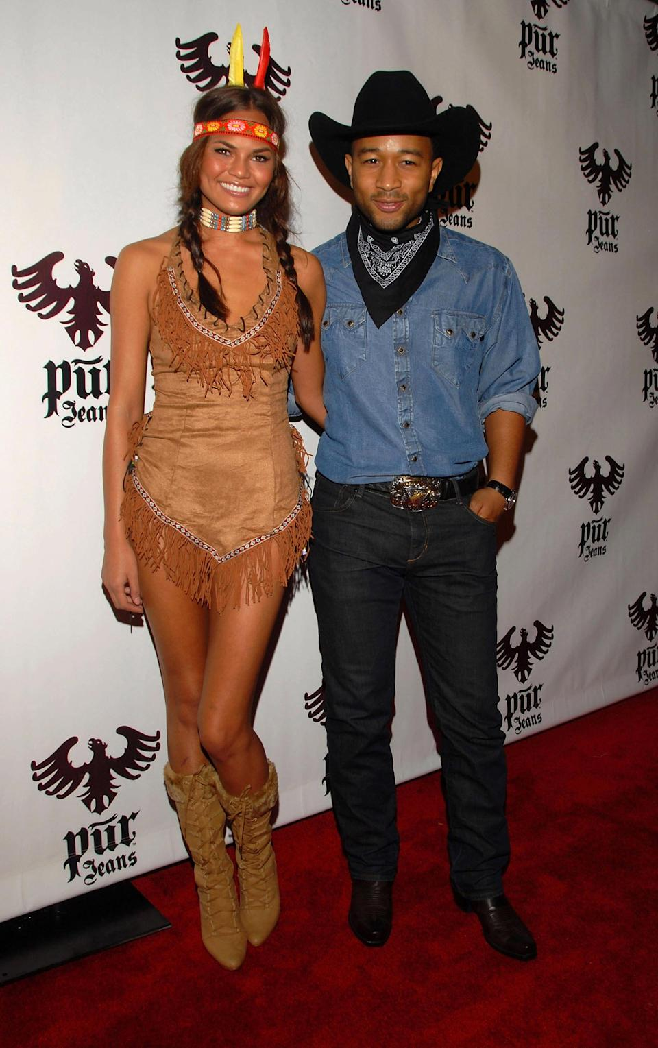 <p>Cultural appropriation apparently wasn't as big of a deal in 2008 when Chrissy Teigen went as a sexy Native American alongside her cowboy husband, John Legend.<br><i>[Photo: Getty]</i> </p>