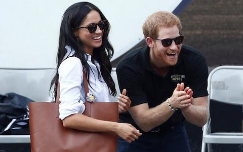 Britain's Prince Harry and his girlfriend actress Markle watch the wheelchair tennis event - Credit: MARK BLINCH/REUTERS