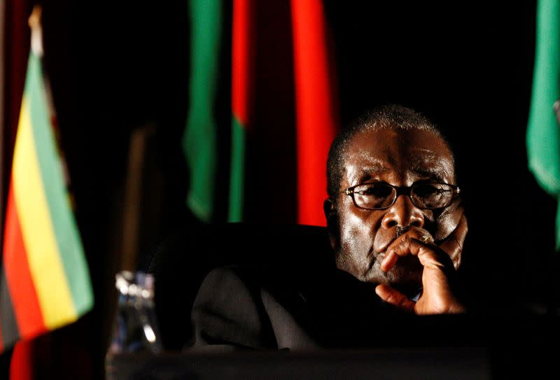 FILE PHOTO: Zimbabwean President Robert Mugabe watches a video presentation during SADC summit in Johannesburg