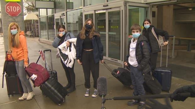 A group of travellers arrive from Quebec en route to Whistler, B.C. Sunday Feb. 28, 2021. (Cory Correia/CBC - image credit)