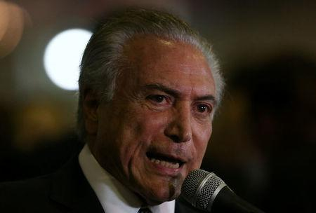 Brazil's President Temer speaks to media during the LAAD, the biggest military industry expo in Latin America, in Rio de Janeiro