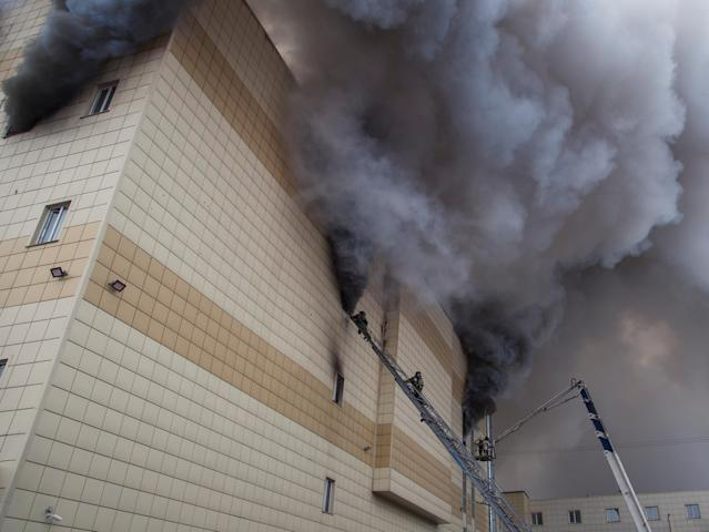 <p>Members of the Emergency Situations Ministry work to extinguish a fire in a shopping mall in the Siberian city of Kemerovo, Russia, on March 25, 2018. (Photo: Marina Lisova/Reuters) </p>