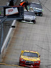 Kurt Busch picked up the victory at Dover, with Jimmie Johnson and Carl Edwards hot on his tail