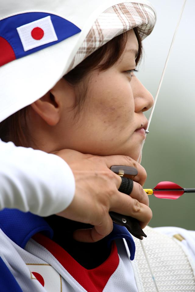 LONDON, ENGLAND - JULY 27: Kaori Kawanaka of Japan aims during the Archery Ranking Round on Olympics Opening Day as part of the London 2012 Olympic Games at the Lord's Cricket Ground on July 27, 2012 in London, England.  (Photo by Paul Gilham/Getty Images)