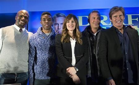"""Cast members Terry Crews, Chadwick Boseman, Jennifer Garner, Kevin Costner and Denis Leary pose at a news conference for the film """"Draft Day"""" in New York"""