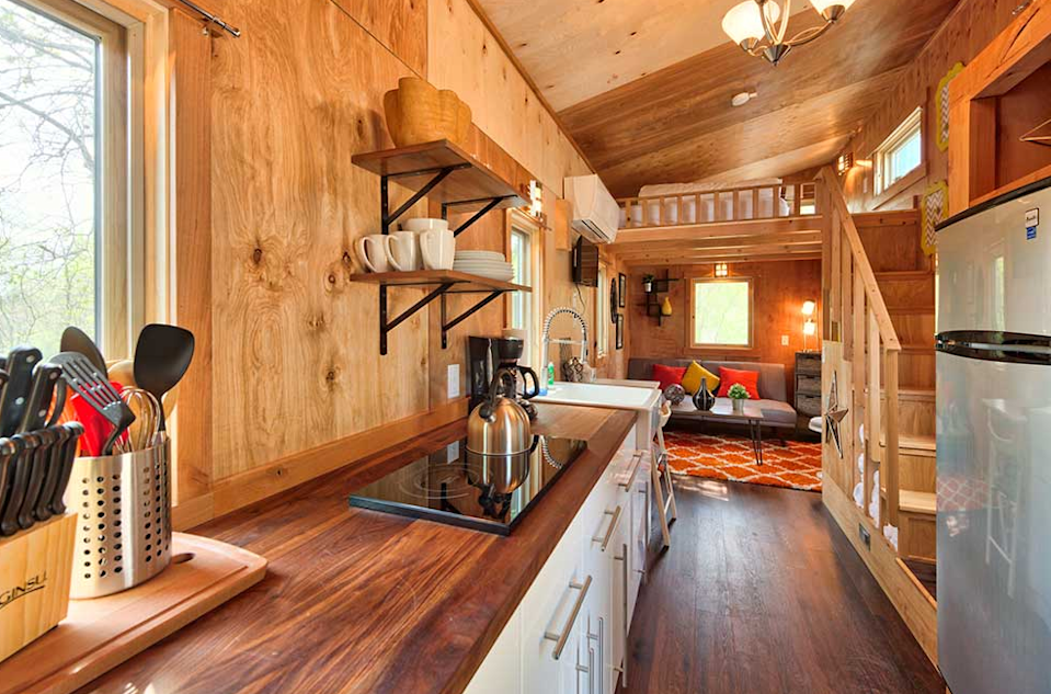 """<p>One of Tumbleweed Tiny House Company's newer models, the Roanoke can sleep up to six people and features a shed style roof.<br></p><p><a class=""""link rapid-noclick-resp"""" href=""""https://go.redirectingat.com?id=74968X1596630&url=https%3A%2F%2Fwww.tumbleweedhouses.com%2Ftumbleweed-models%2Froanoke%2F%23%21&sref=https%3A%2F%2Fwww.oprahdaily.com%2Flife%2Fg35047961%2Ftiny-house%2F"""" rel=""""nofollow noopener"""" target=""""_blank"""" data-ylk=""""slk:SHOP NOW"""">SHOP NOW</a> <a class=""""link rapid-noclick-resp"""" href=""""https://go.redirectingat.com?id=74968X1596630&url=https%3A%2F%2Fwww.tumbleweedhouses.com%2Ftiny-houses-for-sale%2Froanoke%2F%23%21&sref=https%3A%2F%2Fwww.oprahdaily.com%2Flife%2Fg35047961%2Ftiny-house%2F"""" rel=""""nofollow noopener"""" target=""""_blank"""" data-ylk=""""slk:SEE INSIDE"""">SEE INSIDE</a></p>"""