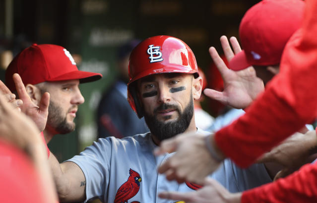 St. Louis Cardinals' Matt Carpenter (13) celebrates in the dugout scoring in the fourth inning of a baseball game against the Chicago Cubs on Saturday, Sept. 29, 2018, in Chicago. (AP Photo/Matt Marton)