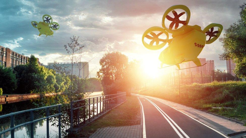 Artistic montage of flying taxis crossing the skies of a city with empty roads