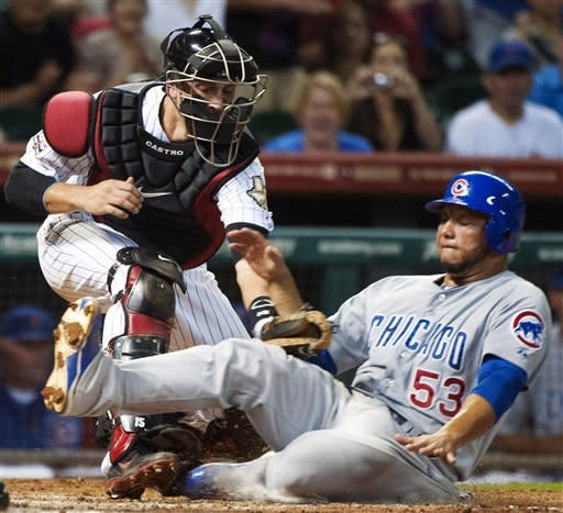 Chicago Cubs' Welington Castillo (53) is tagged out by Houston Astros catcher Jason Castro, left, while trying to score on a single by Joe Mather during the fourth inning of a baseball game, Monday, Sept. 10, 2012, in Houston. (AP Photo/Dave Einsel)