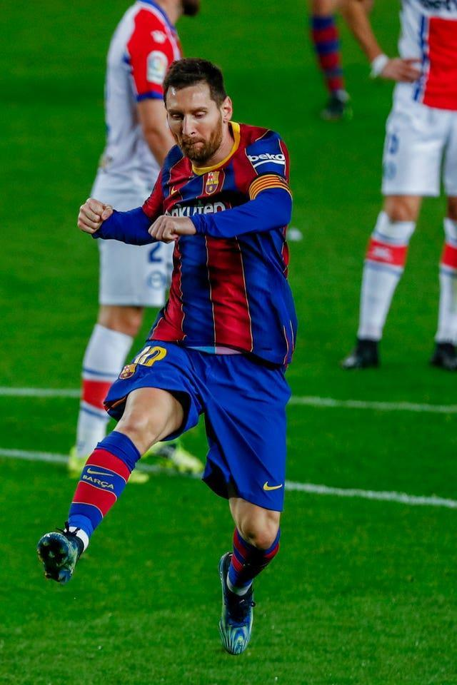 Barcelona's Lionel Messi celebrates after scoring one of his two goals in a record-equalling 505th appearance for the club