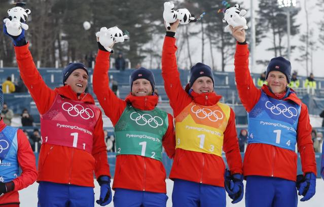Cross-Country Skiing - Pyeongchang 2018 Winter Olympics - Men's 4x10 km Relay - Alpensia Cross-Country Skiing Centre - Pyeongchang, South Korea - February 18, 2018 - Gold medallists Didirk Toenseth, Johnsrud Martin Sundby, Simen Hegstad Kreuger and Johannes Hoesflot Klaebo of Norway celebrate. REUTERS/Jorge Silva