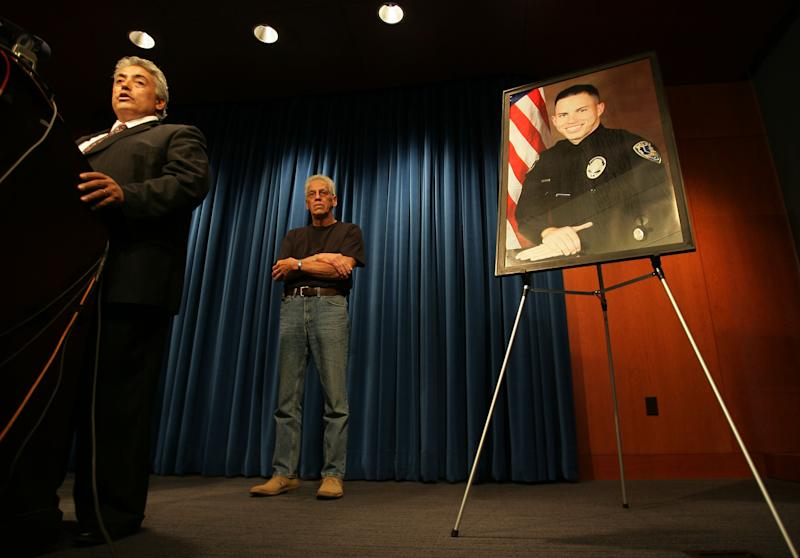 Riverside County District Attorney Rod Pacheco, left, announces charges filed against Earl Ellis Green for the murder of Riverside Police Officer Ryan Bonaminio, pictured at right, during a news conference on Monday, Nov. 15, 2010 in Riverside, Calif. In back is Ryan's father Joe Bonaminio. (AP Photo/The Press Enterprise, Stan Lim)