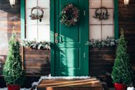 <p>If you're going for a symmetrical look, you need to decorate each side of your porch to match. So whether it's with wreaths, garlands, or trees, don't forget to buy two of everything! </p>