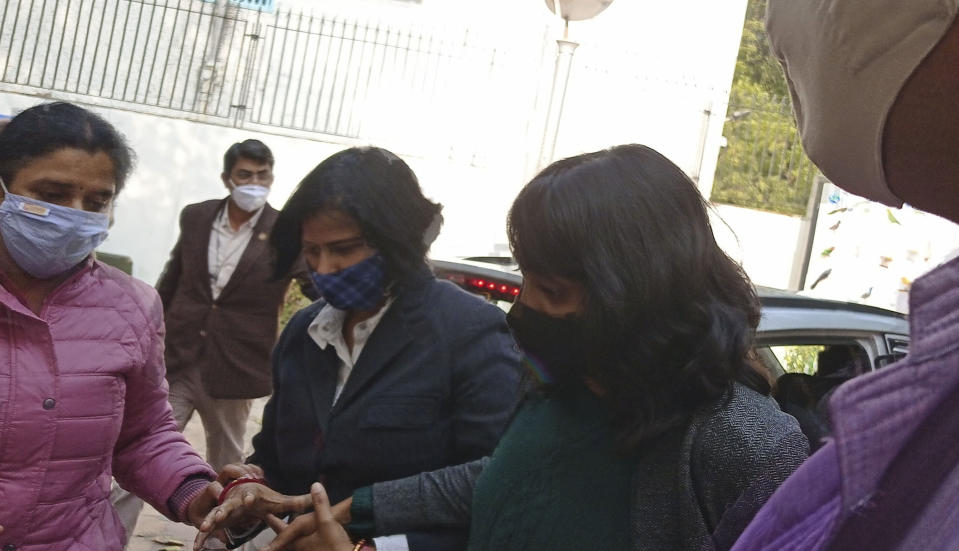 Climate activist Disha Ravi, 22, walks outside a court in New Delhi, India, Friday, Feb. 19, 2021. An Indian court on Friday sent the activist to judicial custody for three days. Ravi was arrested for circulating a document on social media supporting months of massive protests by farmers in India. Her arrest marks the latest example of a crackdown on dissent under Prime Minister Narendra Modi's government, critics say. (AP Photo/Dinesh Joshi)
