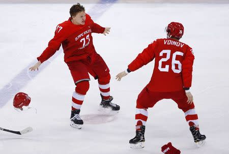 Ice Hockey - Pyeongchang 2018 Winter Olympics - Men's Final Game - Olympic Athletes from Russia v Germany - Gangneung Hockey Centre, Gangneung, South Korea - February 25, 2018 - Kirill Kaprizov, an Olympic Athlete from Russia, celebrates scoring a goal with team mate Vyacheslav Voinov. REUTERS/Brian Snyder