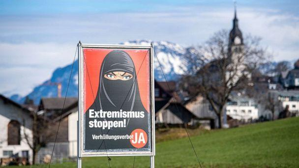 PHOTO: A poster supporting the initiative 'Yes to a ban on covering the face' is displayed at the village of Buochs, Switzerland, on Feb. 16, 2021. (Urs Flueeler/Keystone via AP)