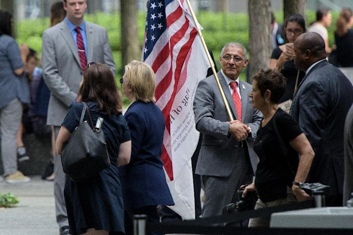Democratic presidential nominee Hillary Clinton leaves a memorial service at the National 9/11 Memorial on September 11, 2016 in New York (AFP Photo/Brendan Smialowski)
