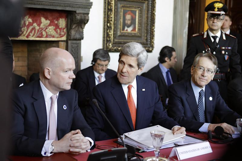 U.S. Secretary of State John Kerry, center, sits between Italian Foreign Minister Giulio Terzi, right, and British Foreign Secretary William Hague during meetings at Villa Madama in Rome on Thursday, Feb. 28, 2013. Rome is the fourth leg of Kerry's first official overseas trip, a hectic nine-day dash through Europe and the Middle East. (AP Photo/Jacquelyn Martin, Pool)