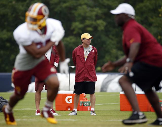 Washington Redskins owner Daniel Snyder, center, watches practice at the team's NFL football training facility, Sunday, July 27, 2014 in Roanoke, Va. (AP Photo/Alex Brandon)